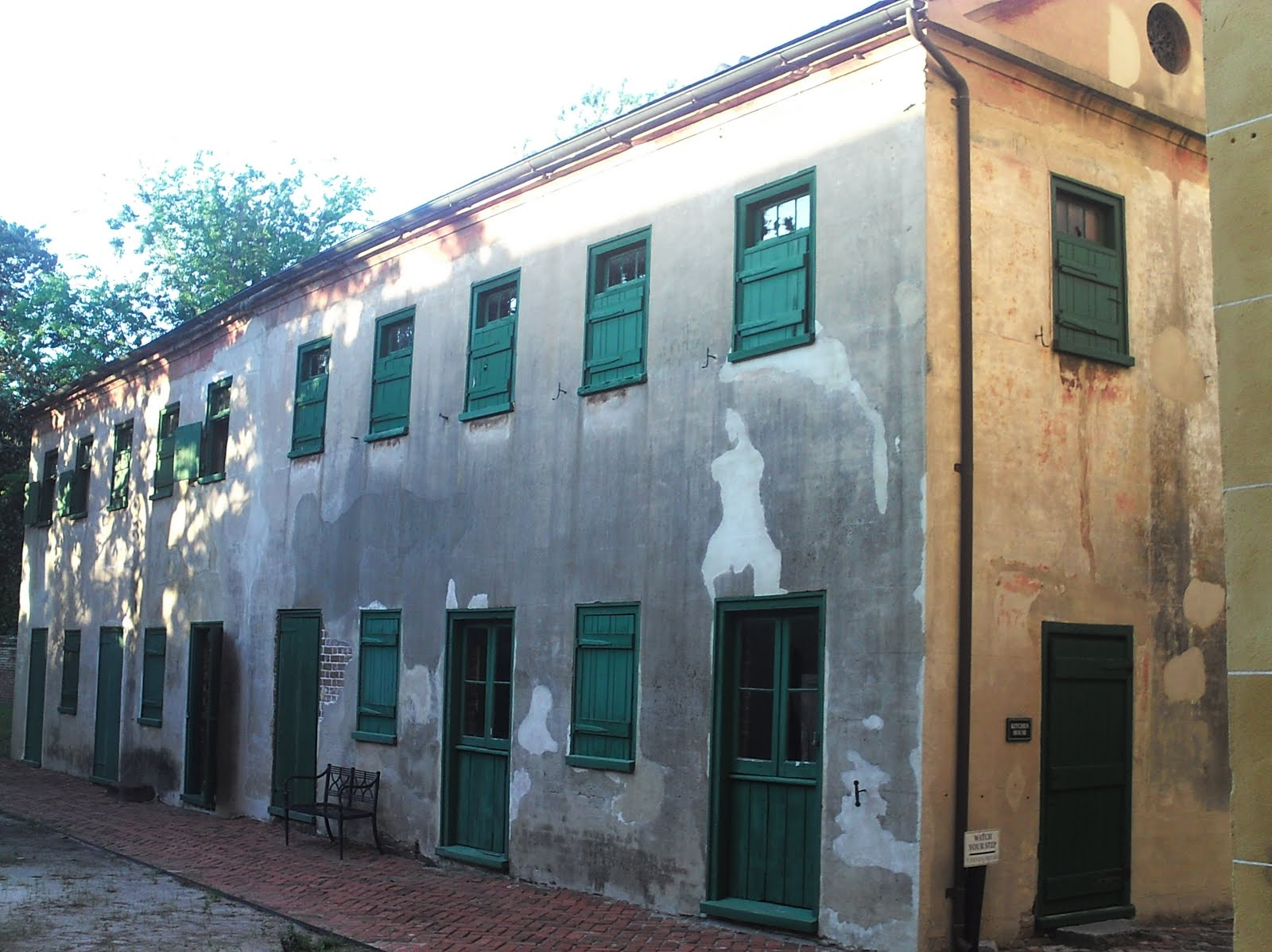 Photo of the old slave quarters courtesy of aboutourfreedom.com