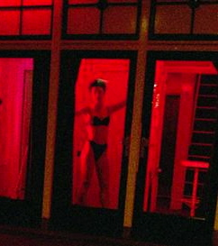 """Mannequin"" bathed in red light."