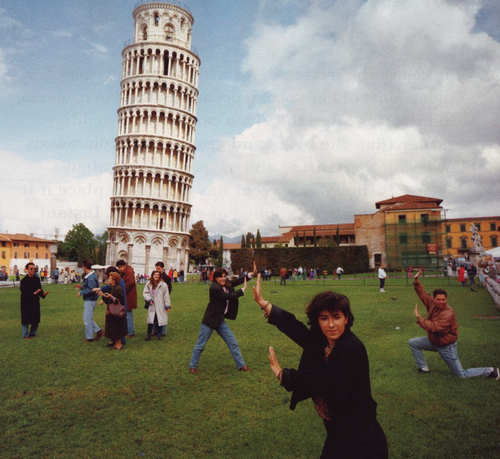 "Tourists, don't make it hard to love you!  The Leaning Tower of Pisa honestly is filled with people ""holding it up.""  Facepalm."